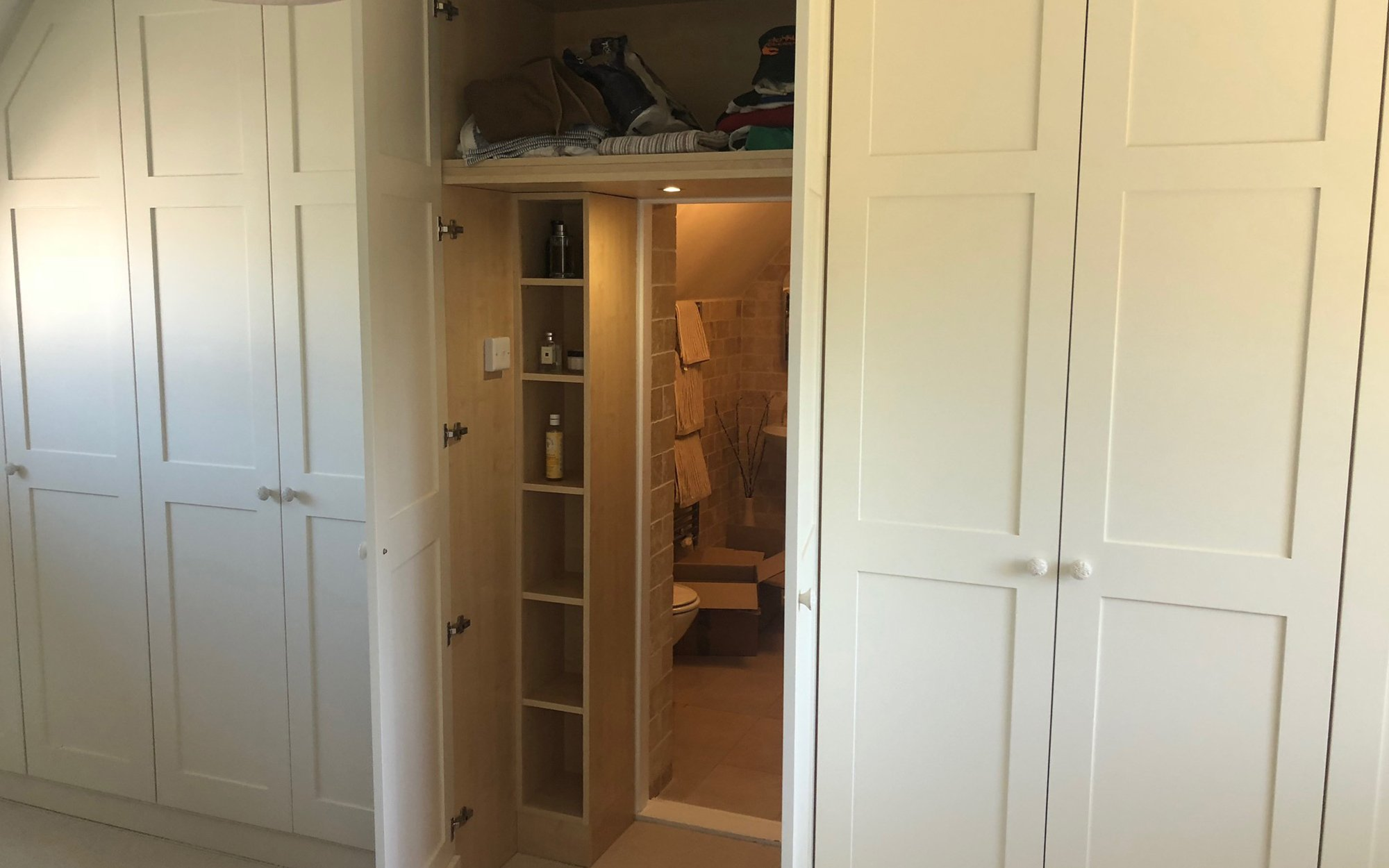 Walk-In Wardrobe with Concealed En-Suite Entrance - Bourne's Fine Furniture