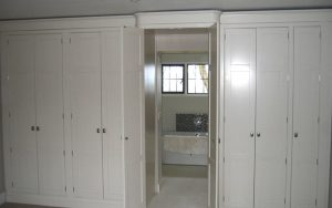 Fitted Walk-In Wardrobe with Concealed En Suite Entrance - Bourne's Fine Furniture