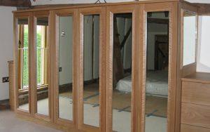 Freestanding Wooden Wardrobes with Mirrored Door Panels - Bourne's Fine Furniture