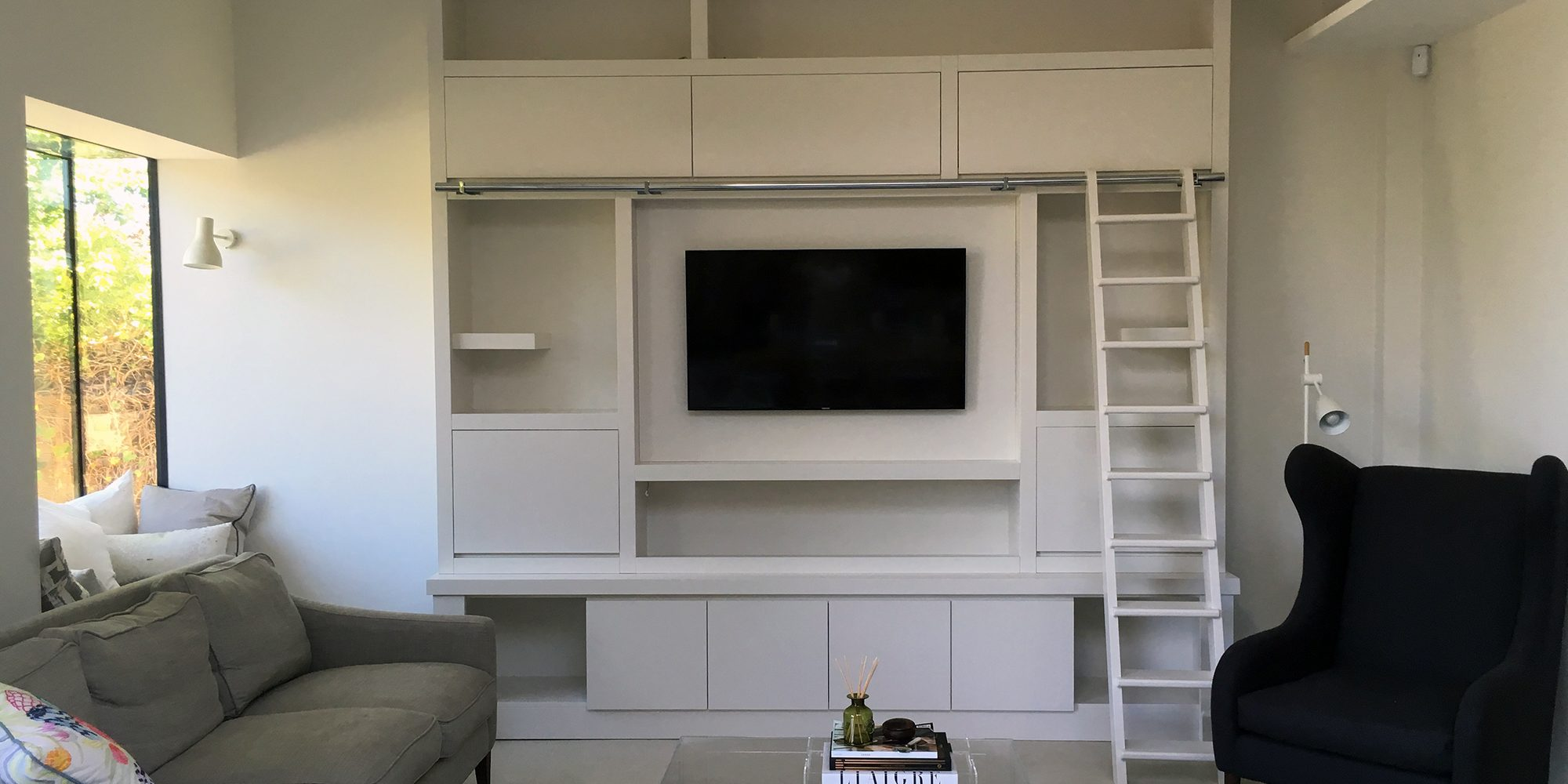 Bespoke White Living Room Furniture with TV Unit and Ladder - Bourne's Fine Furniture Sussex